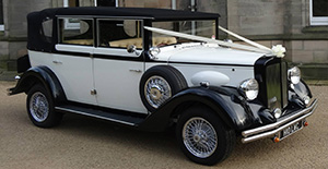Regent Landaulet In Black And Ivory With Wired Wheels