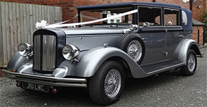 Regent landaulet in silver with wired wheels